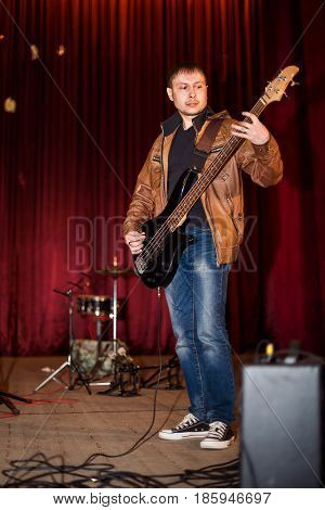 The guitarist plays the guitar at a concert