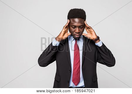 Young African Man In Formalwear Touching His Head With Hands While Standing Against Grey Background