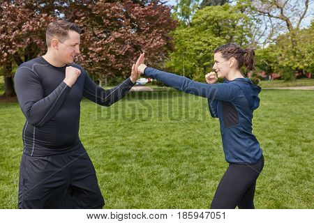 Man boxing with Personal Trainer at the park