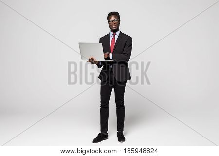 African American Young Business Man With Laptop On Grey Background