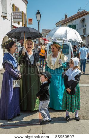 Saint-Marie-de-la-Mer, Provence, France - May 25, 2015. Women and children in fabulously beautiful medieval clothes. The gypsies feast of St. Sara. The concept of ethnographic tourism
