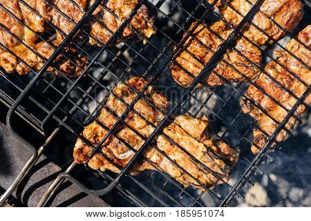 Pieces of fried lamb meat and pork on the grill. Delicious festive barbecue. Marinated beef BBQ Skewers. Food and holliday concept.