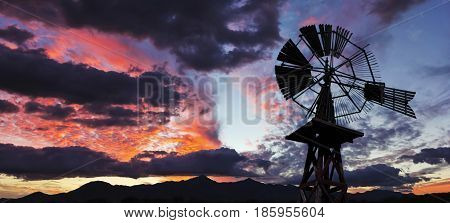 A Gorgeous Red and Blue Sunset an Old Windmill and a Mountain Horizon