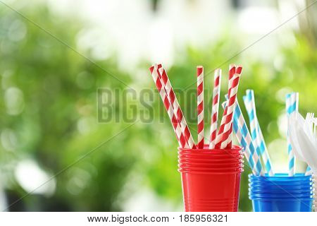 Plastic ware on blurred background outdoors