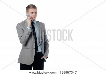 young businessman talking on the phone. in a business suit on a white background.