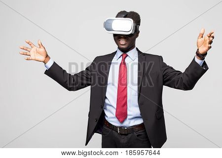 Astonished African Businessman In Checkered Suit Experiencing Virtual Reality While Using Oculus Rif