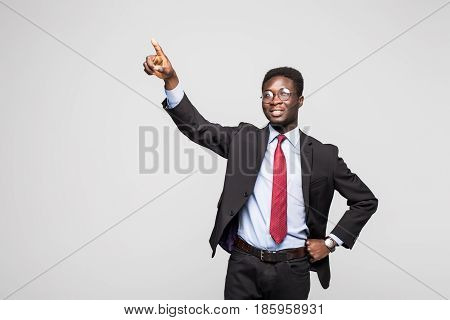 African Businessman Pointing At Something On White Background