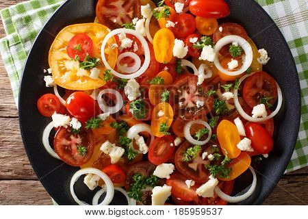 Vitamin Salad From Multi-colored Tomatoes, Onions And Blue Cheese Close-up. Horizontal Top View