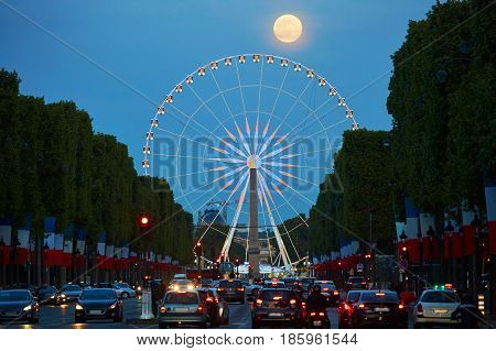 Observation Wheel On Champs-elysees Street With Full Moon In Paris, France