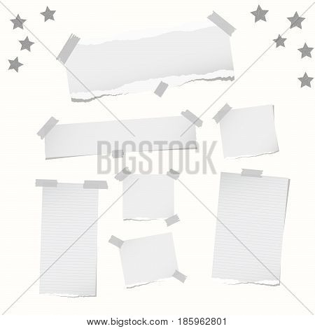 Ripped note, notebook, copybook paper strips, stars, stuck with sticky tape on white background