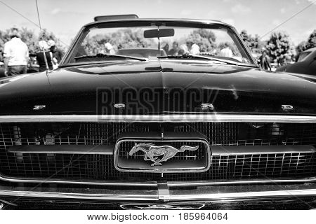 Paaren Im Glien, Germany - May 19: The Emblem Of A Sports Car Ford Mustang Convertible (1967), Black