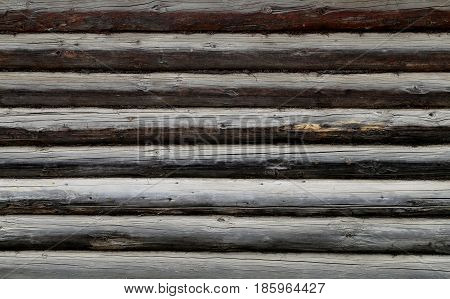 Beautiful texture of wooden logs Russian house to photograph closeup
