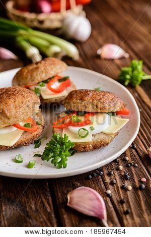 Fried Patty Filled With Cheese, Egg, Bell Pepper And Scallion