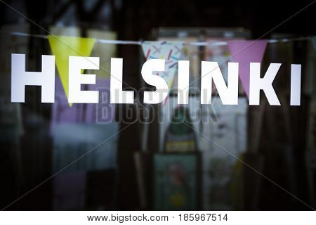 Helsinki sign in store window in the Finnish capital