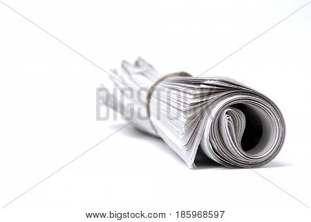Newspaper rolled up isolated on white for news stories and information