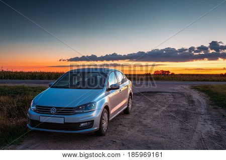 Gomel, Belarus - August 24, 2016: Volkswagen Polo Sedan Car Parking On A Roadside Of Country Road During Sunset Or Sunrise