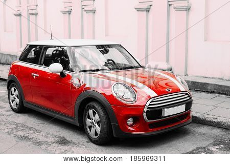 Vilnius, Lithuania - July 7, 2016: Red Color Car With White Stripes Mini Cooper Parked On Street In Old Part European Town.