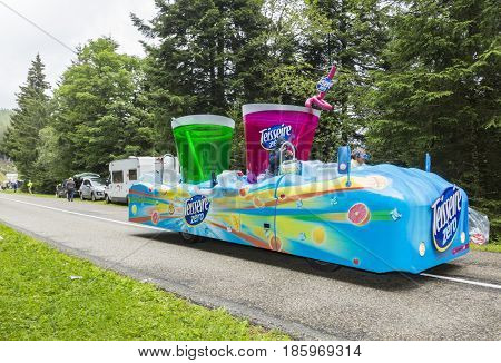 Col de Platzerwasel France - July 14 2014: Teisseire vehicle during the passing of the advertising caravan in front of the audience on the road to Mountain Pass Platzerwasel in Vosges mountains during the stage 10 of Le Tour de France 2014 the biggest cyc