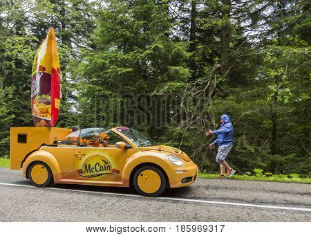 Col de Platzerwasel France - July 14 2014: McCain vehicle during the passing of the Publicity Caravan in front of the audience on the road to Mountain Pass Platzerwasel in Vosges mountains in the stage 10 of Le Tour de France on July 14 2014. Before the a