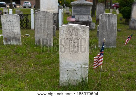 Toms River NJ USA--May 6 2017 -- Gravestones with flags mark where veterans lie buried. Editorial Use Only.