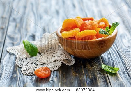 Dried Apricots In Wooden Bowl.