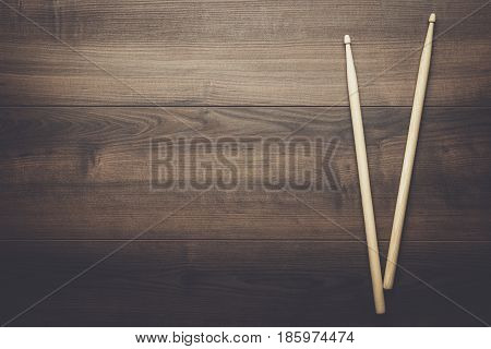 pair of wooden drumsticks. drumsticks on wooden background. pair of drumsticks on brown table. wooden background with drumsticks and copy space