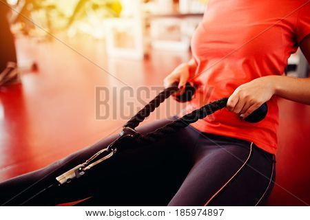 girl is doing an exercise on the widest muscles. in the gym. hands close-up