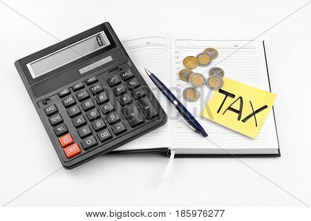 Paper sheet with text TAX, notebook, coins and calculator on white background