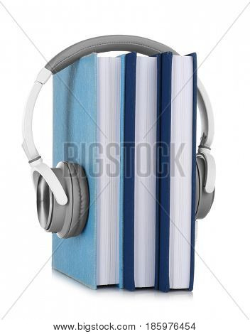 Audiobook concept. Pile of books and headphones on white background