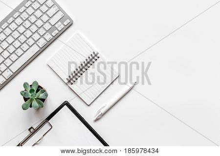 office desk design with notebook and keyboard on white background top view space for text