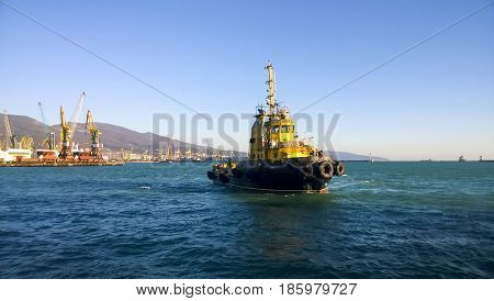 A Small Service Ship In A Cargo Industrial Port. A Ship In The Sea