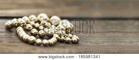 Golden pearls necklace closeup vintage background banner