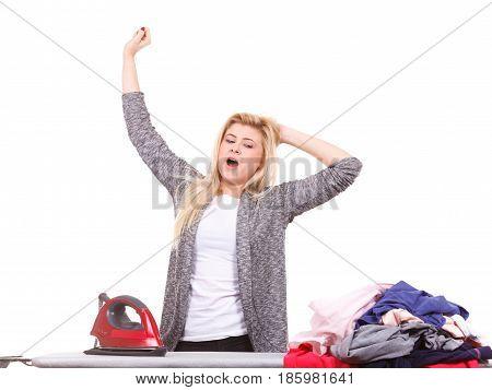 Tired Woman Yawning While Doing Ironing
