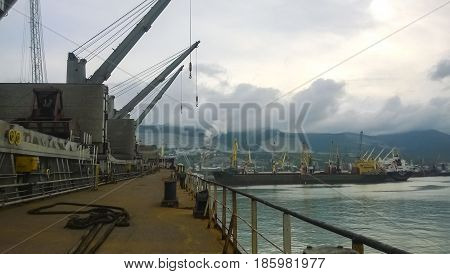 The Type Of Port Cranes In The Background Of The Landscape Of The Port And Port Area