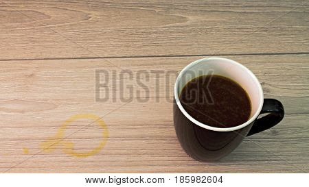 Black and white Coffee cup with coffee stain