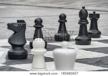 Life size chess pieces and giant chess board