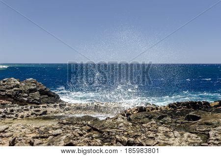 Wave To Produce Salt. Traditional Methods Of Sea Salt Production In Salinas Del Carmen, Fuerteventur