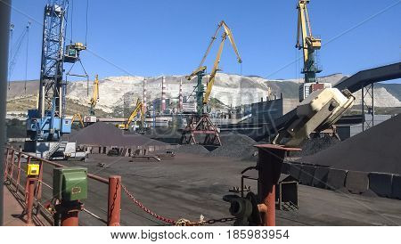 Cargo Industrial Port, Port Cranes. Loading Of Anthracite. Transportation Of Coal. Heap Of Coal