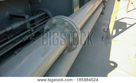 Flanged Connection On A Gray Pipe. Pipes On The Deck Of The Ship