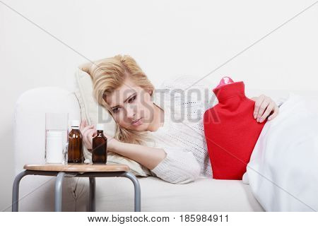 Woman Feeling Stomach Cramps Lying On Cofa