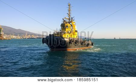 A Small Service Ship In A Cargo Industrial Port. A Ship In The S