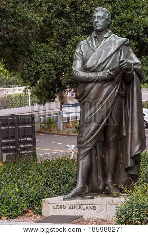 Auckland New Zealand - March 5 2017: Bronze statue of standing Lord Auckland set in green vegetation on Aotea Square.