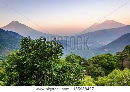Dawn over three volcanoes: Agua, Fuego & Acatenango near Antigua, Guatemala, Central America