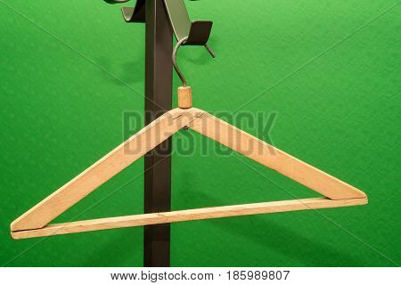 Two different coat hangers on green background