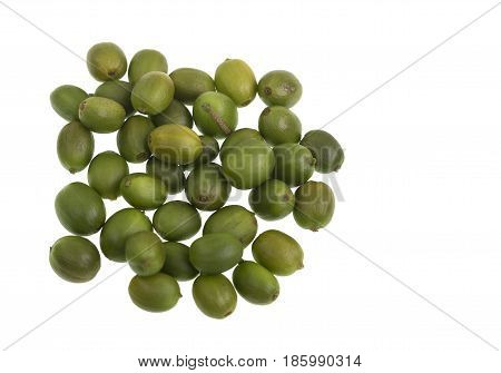 Green and unripe coffee beans isolated on a white background