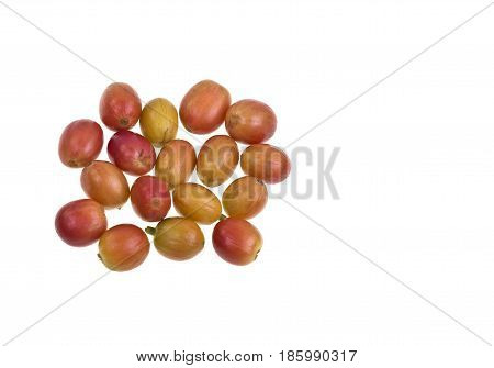 Yellow and half-ripe coffee beans isolated on a white background