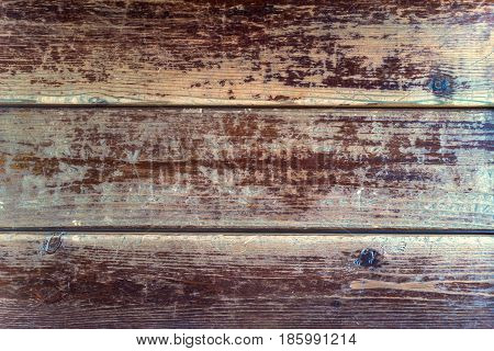Texture of dark wooden planks with some spaces between them