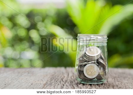money in the glass concept saving money growing business