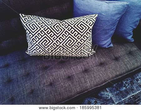 Luxurious dark blue sofa with cushions. Contemporary furniture.