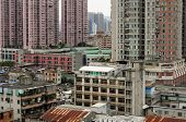 Weathered apartment buildings in the Xiguan district in the city of Guangzhou China near Shang Xia Jiu Pedestrian Street on an overcast day in Guangdong province. poster